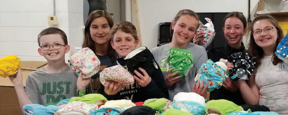youth groups packing cloth diapers volunteering